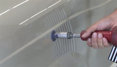 Paintless car dent removal